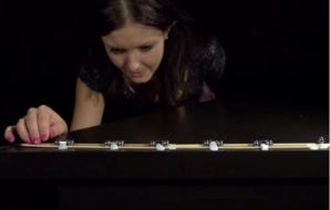 Woman looking at magnets on a track