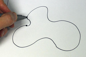 someone drawing a blobby loop shape.