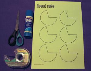Template, scissors, glue, sticky tape.
