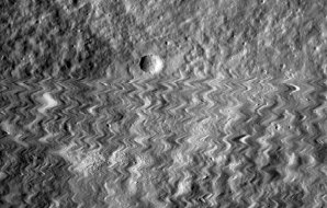 A wiggly photo of a cratered surface.
