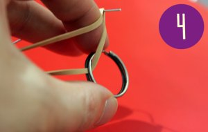 Rubber band wound half way onto a metal ring.