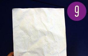 a slightly wrinkled, blank sheet of paper