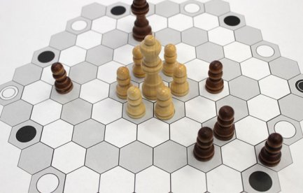 Hexagonal board game with chess pieces on it.