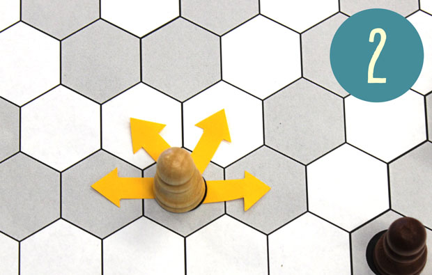Hexagonal places on a board with yellow arrow showiing four directions where chess piece can move.