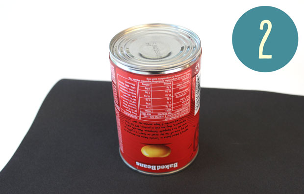 Can of beans on a piece of sandpaper.