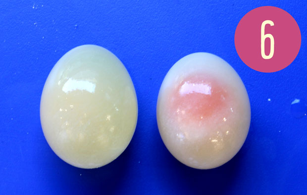 Two shell-less eggs, one transparent.