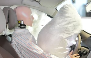 Inflated airbag and manequin