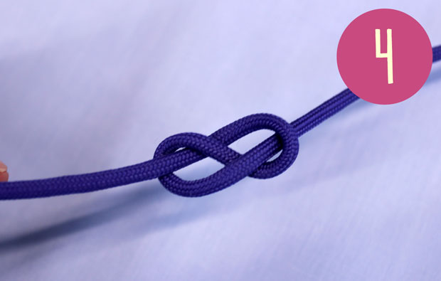 A purple string with a loosely tied figue of 8 knot.