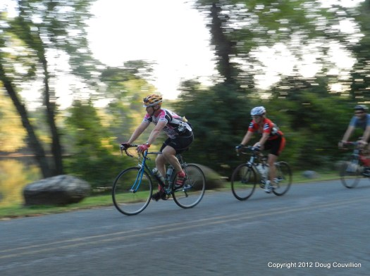 photograph of cyclists riding near the James River
