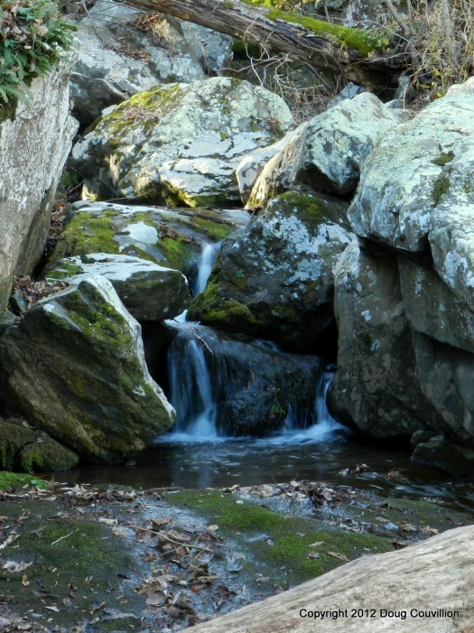 photograph of a cascade between boulders in Shenandoah National Park