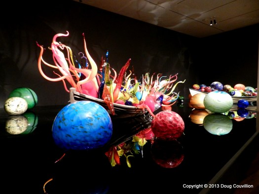 photograph of a Chihuly exhibit of glass in a boat