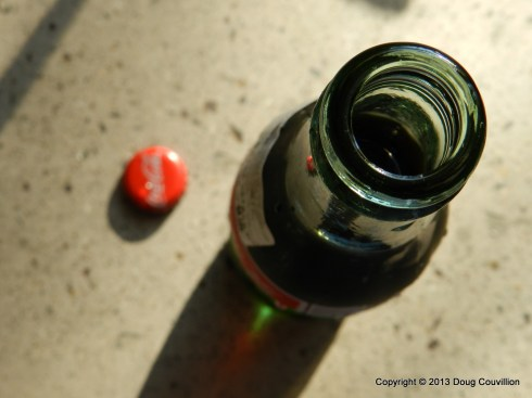 photograph of a soda bottle and bottle cap