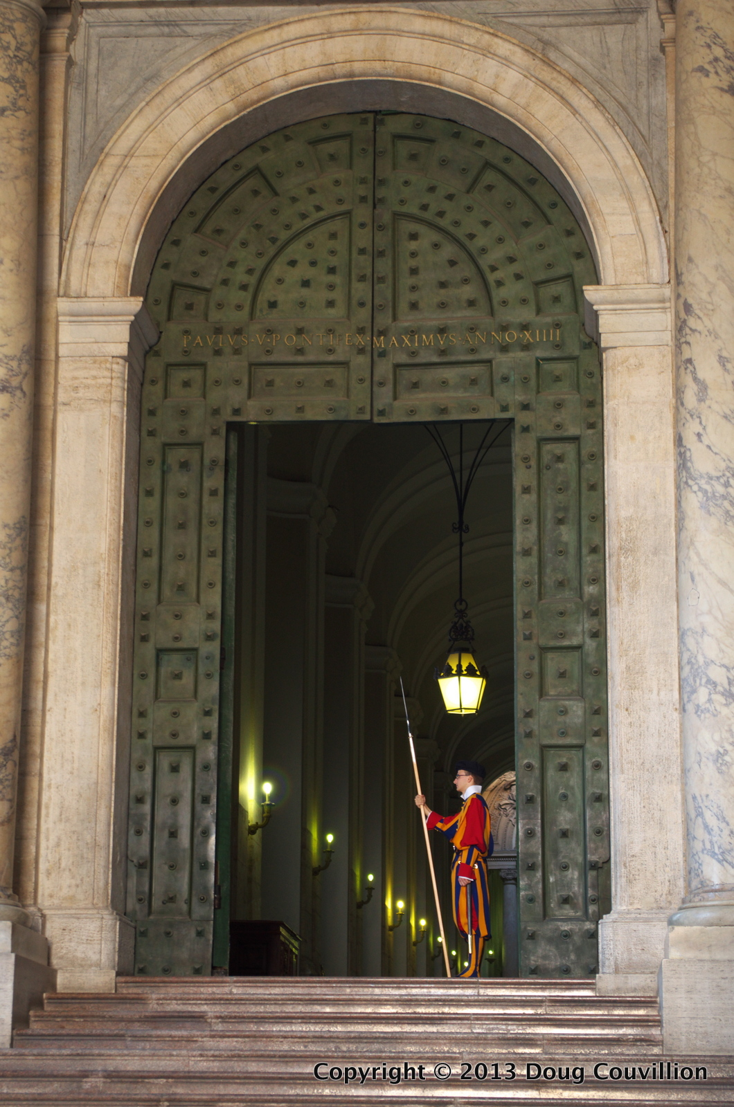 photograph of a guard at the Vatican standing in a door way