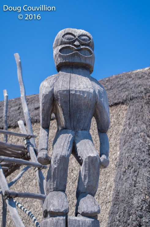 Photograph by Doug Couvillion: A carved wooden figure at Pu`uhanua O Honaunau National Historic Park, Hawaii