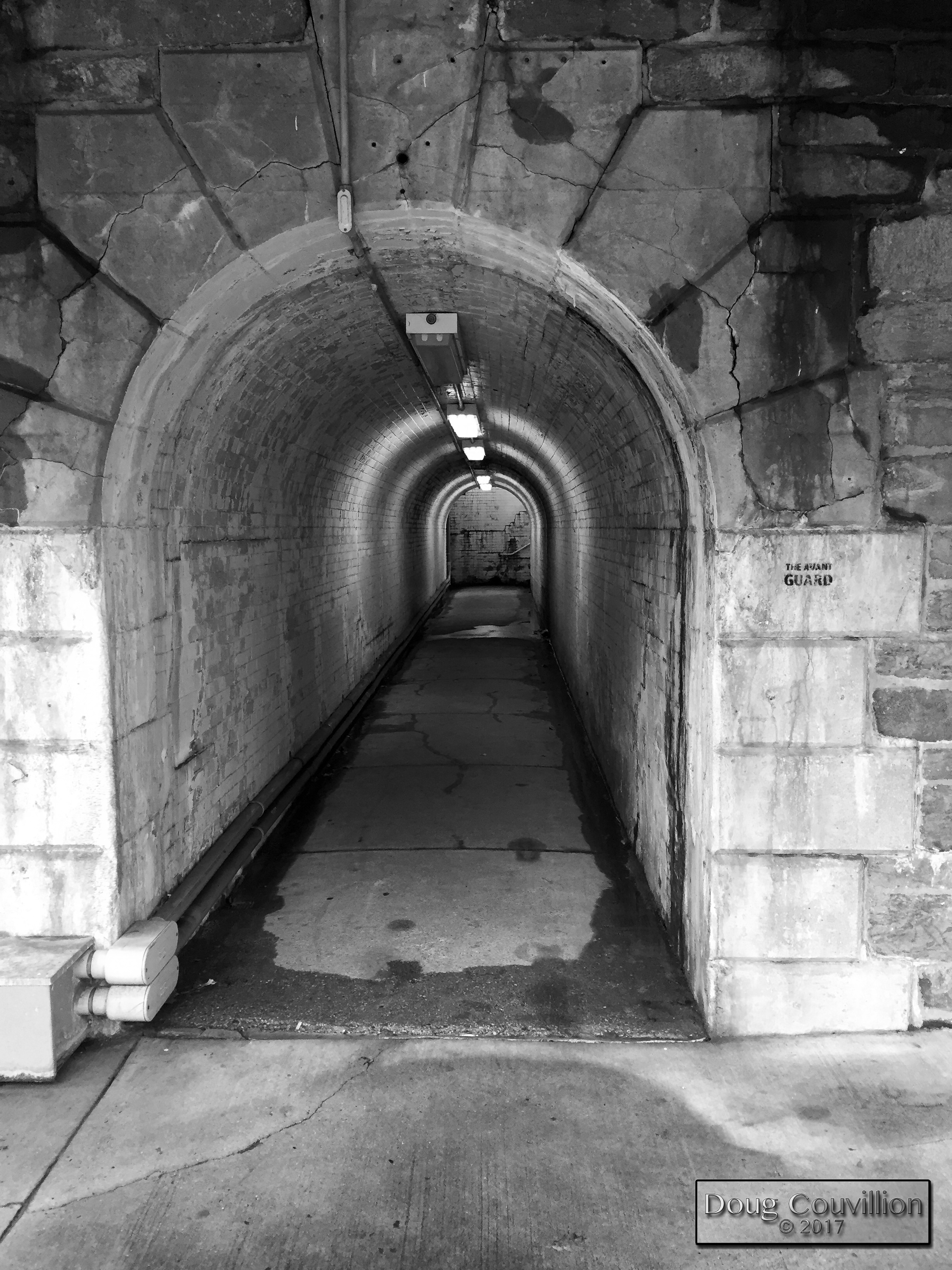 black and white photograph of a pedestrian tunnel by Doug Couvillion
