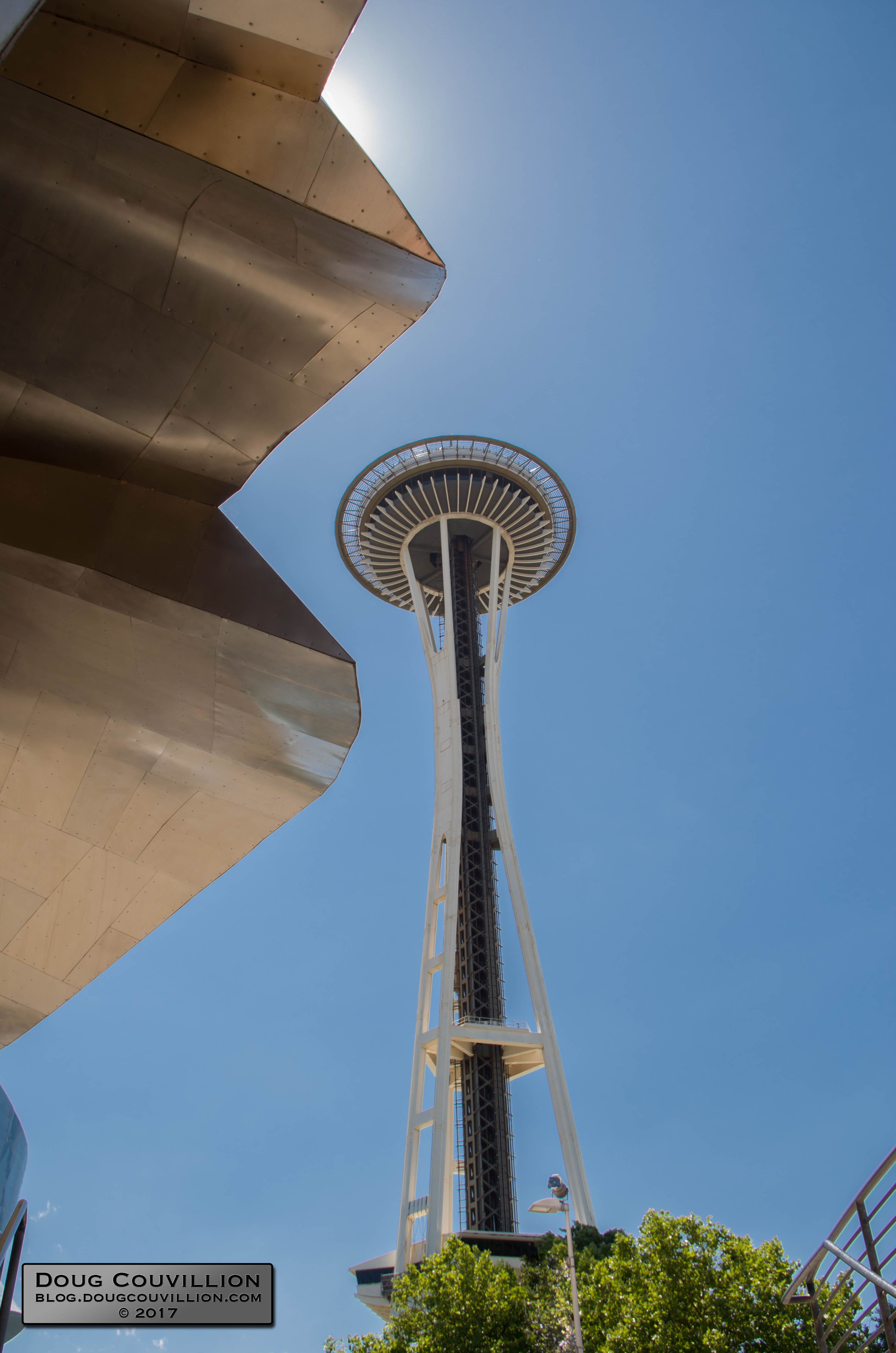 photograph of the Space Needle next to the Museum of Pop Culture in Seattle, Washington by Doug Couvillion