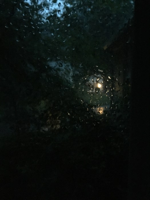 Photograph of rain drops on a window by Doug Couvillion