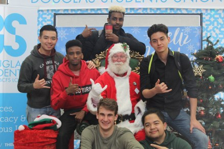 Santa stopped by the New Westminster Campus concourse to strike a pose with students before the start of exam season.