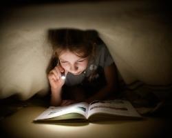 girl_reading_in_blanket_fort