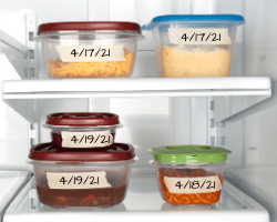 Leftover food in a refrigerator with dates written on each item