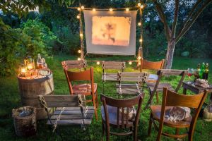 Outdoor Movie Night with Screen and Chairs
