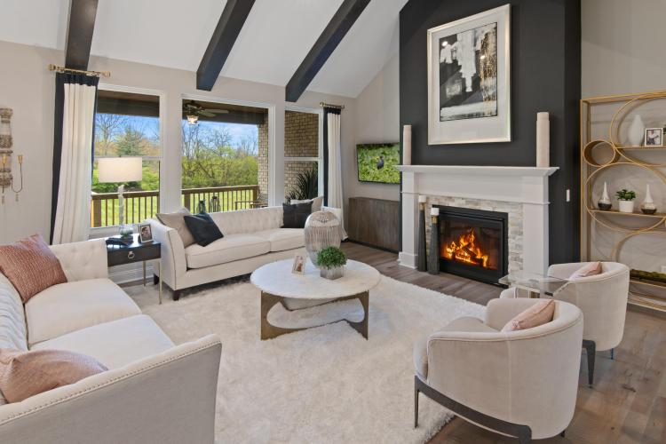The Bennan Family Room with Fireplace by Drees Homes