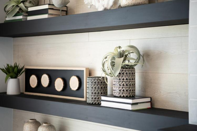 Emerging Home Design Philosophies That Will Dominate in 2021 | The Rowland Family Room with Floating Shelves | Drees Homes