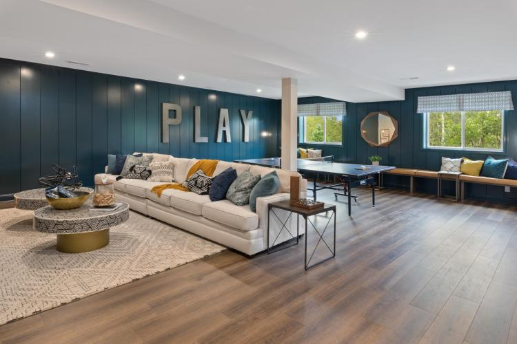 A rec room featuring a ping pong table and sofa area by Drees Homes in Cincinnati