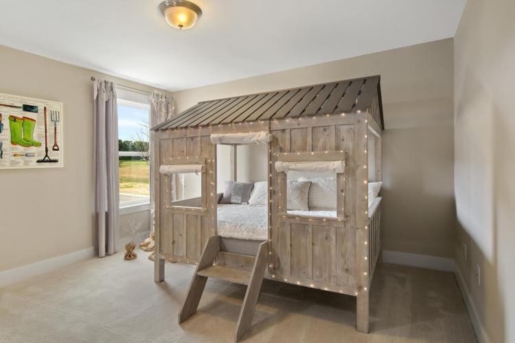 Child's bedroom featuring a tree house theme by Drees Homes in Cincinnati