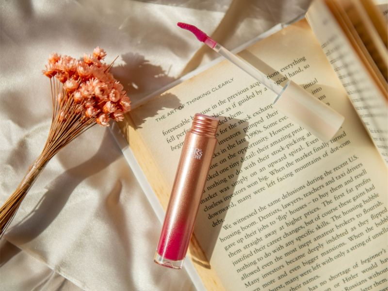 this multi-tasking lip gloss gives you actual lip care benefits