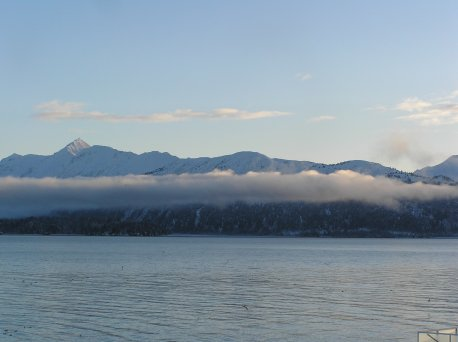 Mountains behind a cloud layer