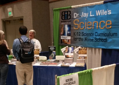 This is me at my publisher's booth talking with two homeschoolers.