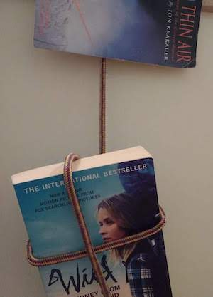Great Outdoors books roped together