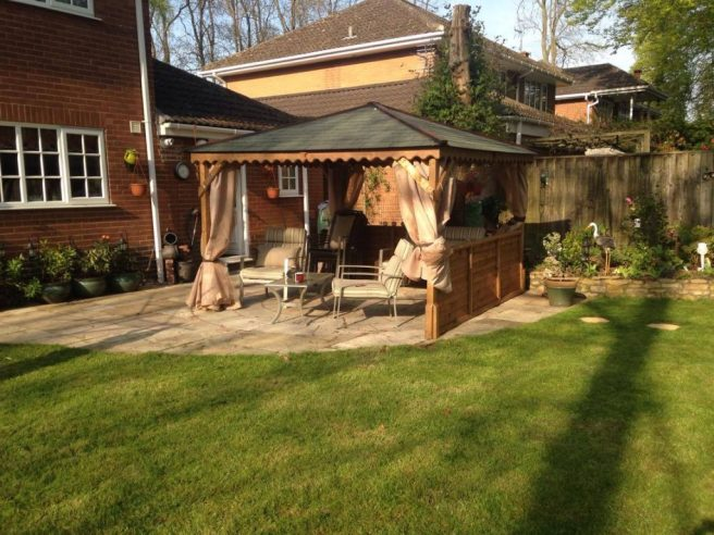Garden Gazebo from Dunster House with garden furniture and decoration