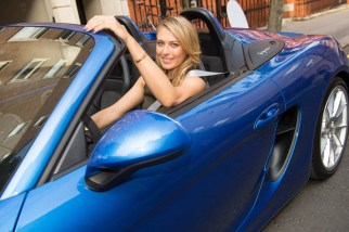 Maria Sharapova drops in at Porsche Mayfair to go for a spin in the UK's only brand new Porsche Boxster Spyder, on her way to the WTA Pre-Wimbledon Party at Kensington Roof Gardens.