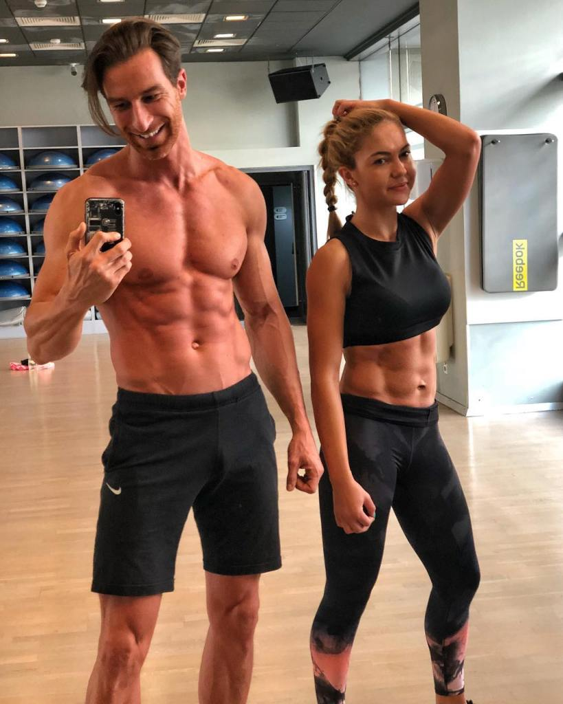 In this picture you can see Dan Iancu, a DY Nutrition Athlete and his Spouse Luana after a gym workout, showing their muscle tone.