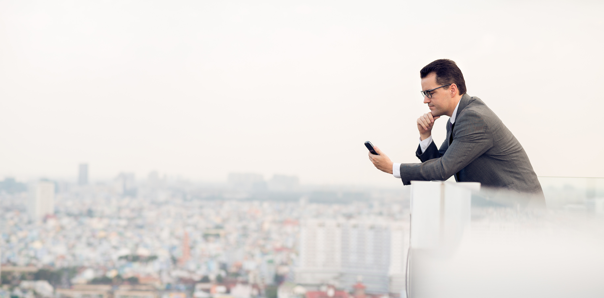 business man on smartphone - 5 apps that are like have a therapist in your pocket