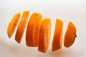 orange sliced up vertically with peel on