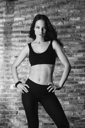 black and white shot of female in workout clothes