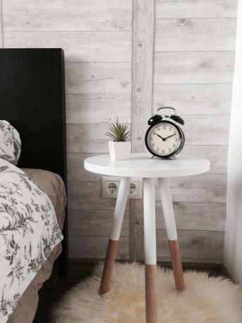 alarm clock sitting on night stand