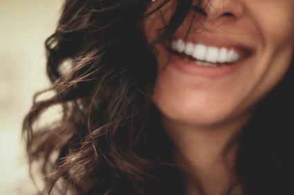 a beautiful female white teeth smile