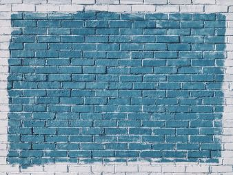 white brick wall painted blue