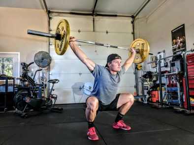 male overhead squatting