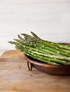 asparagus in a bowl on a table