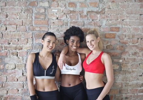 three ladies in workout clothes