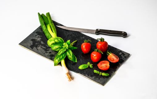 vegetables on a cutting board with knife