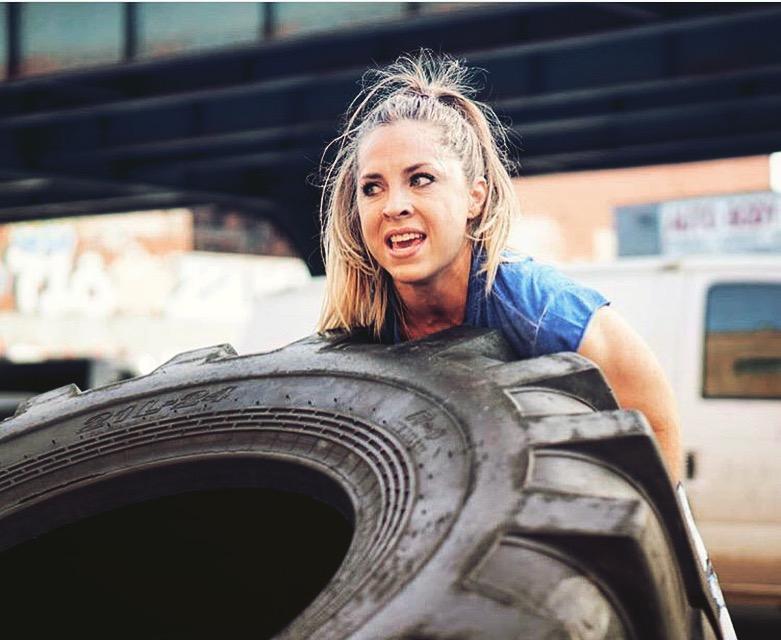 EBOOST Ambassador Amanda Colacicco flipping a tire