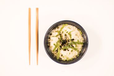 bowl of white rice with chop sticks