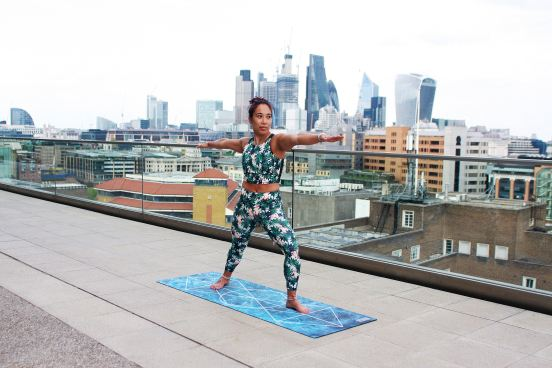 woman on a roof top doing yoga