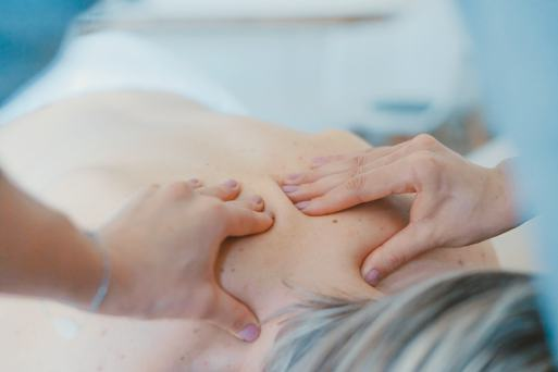 person giving a massage on the upper back